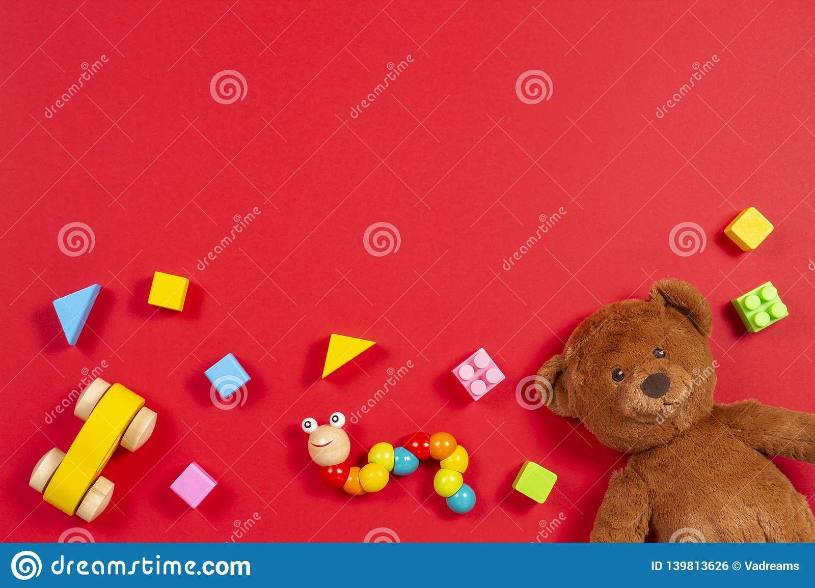 Baby Kids Toys Background Teddy Bear Wooden Car Colorful Bricks On Red Background Stock Photo Image Of Babyshower Doll 139813626