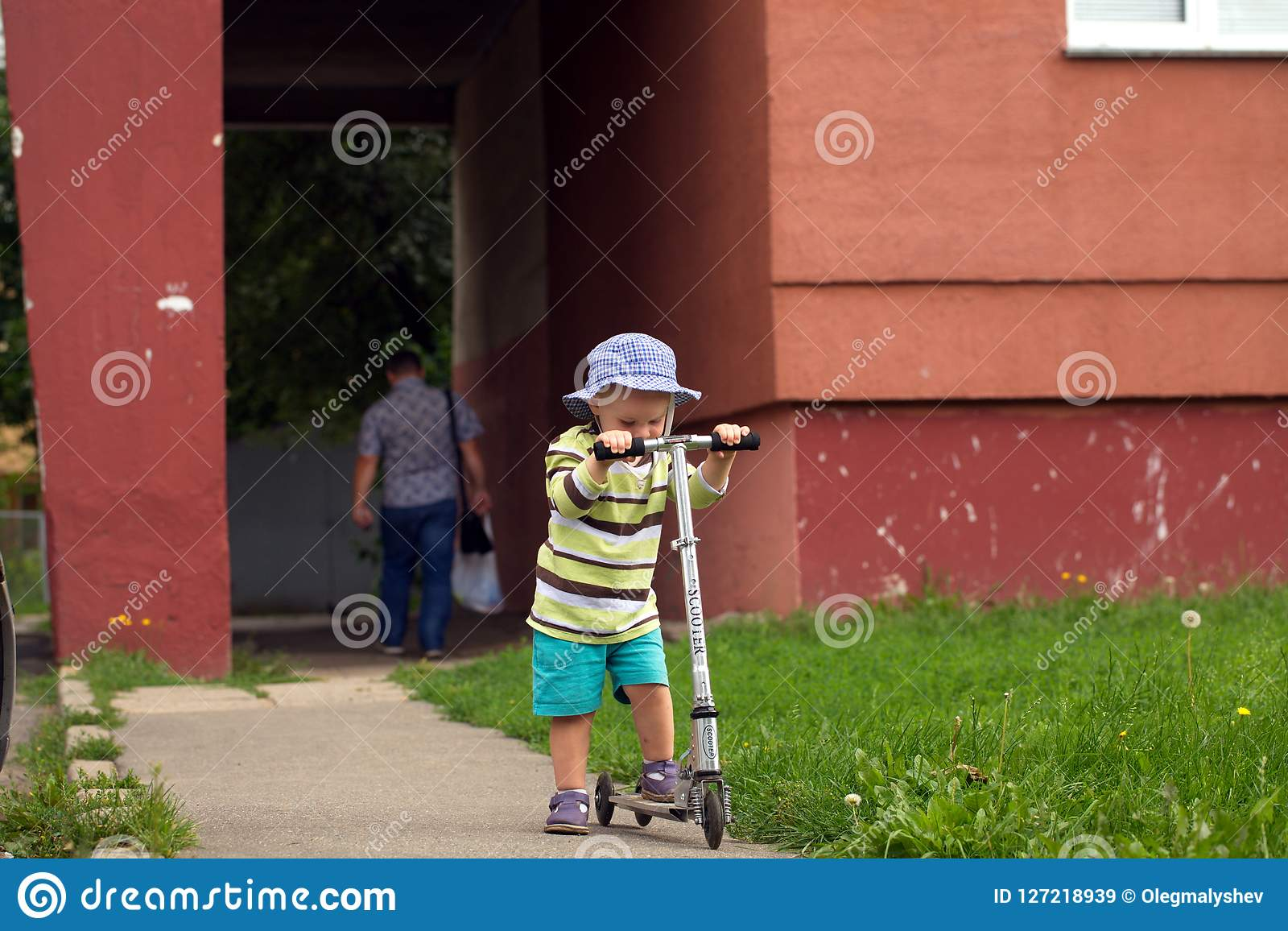 891916036dc0a Funny Child Skates On A City Street On A Scooter Stock Image - Image ...