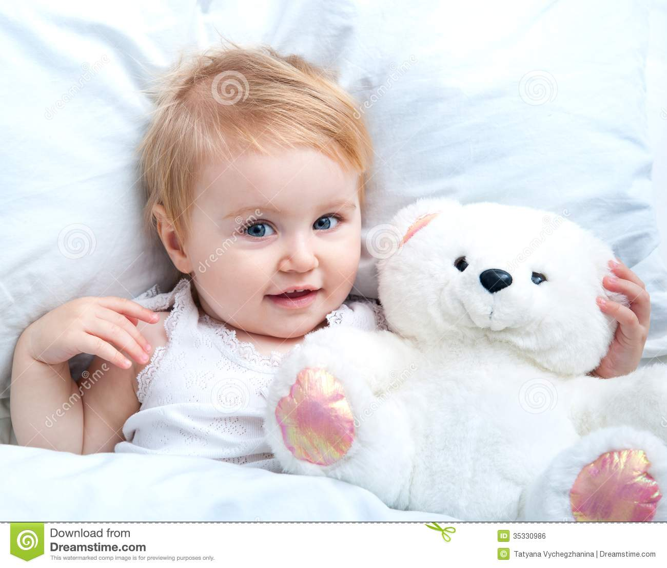 baby lying in a white bed stock photo. image of lifestyle - 35330986