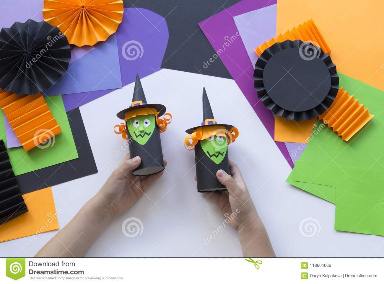 Baby Makes Halloween Witch Doll From Paper By Hands.Creative DIY For Kids. Home  Decor Project Party.Halloween Crafts Inspiration.