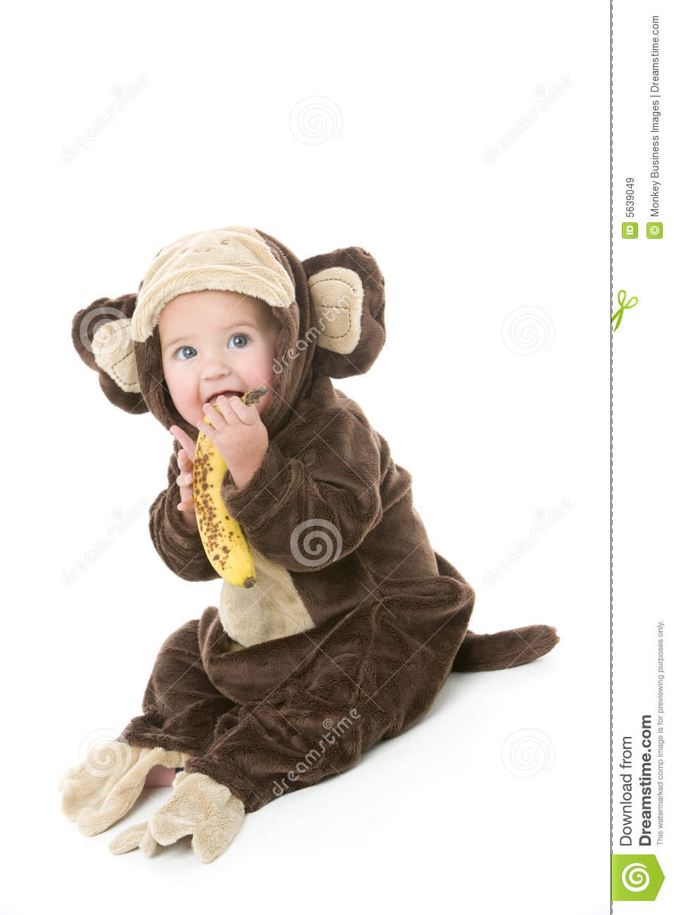 baby in monkey costume holding banana stock image