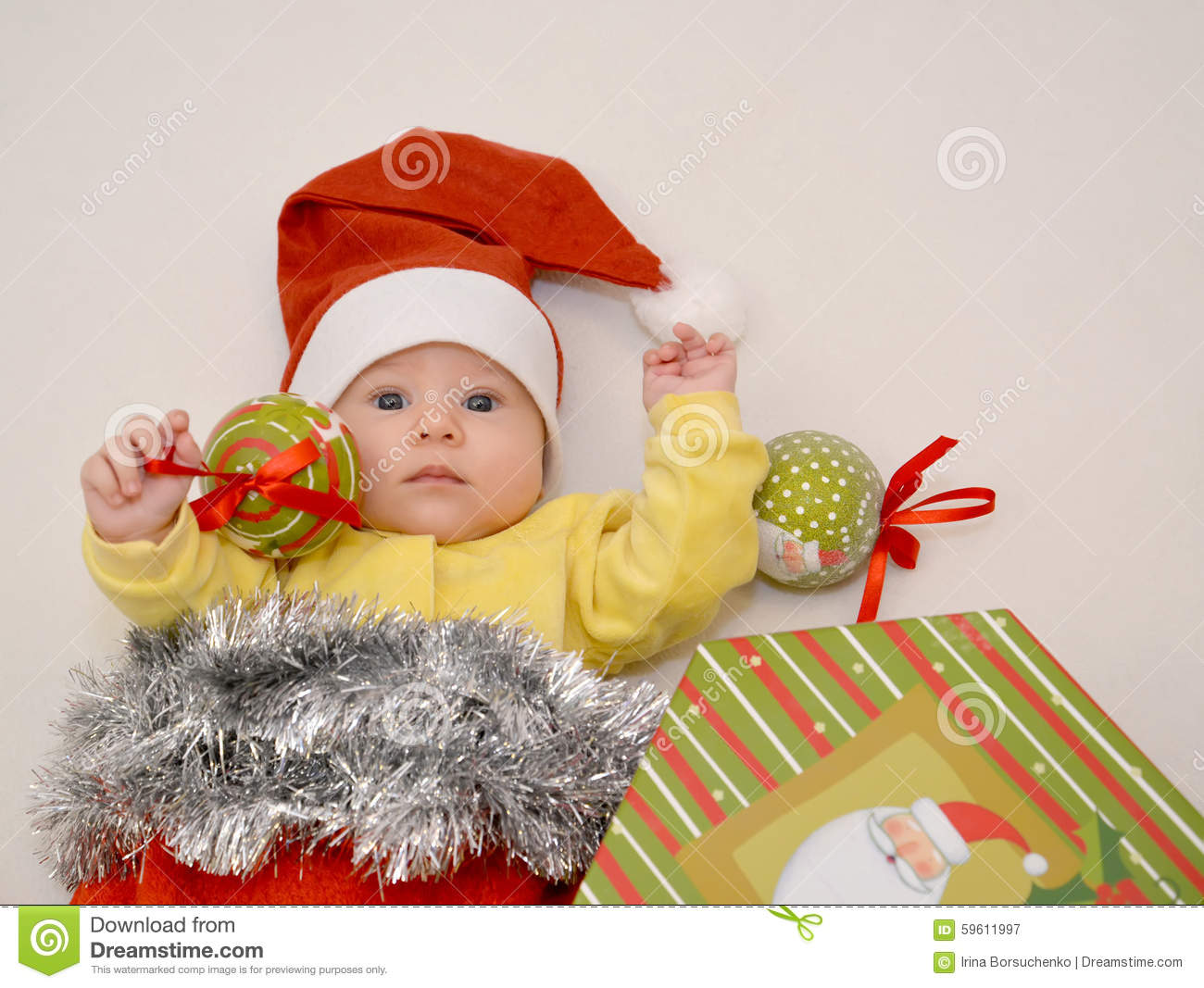 the baby in a new year s suit of santa claus with christmas tree