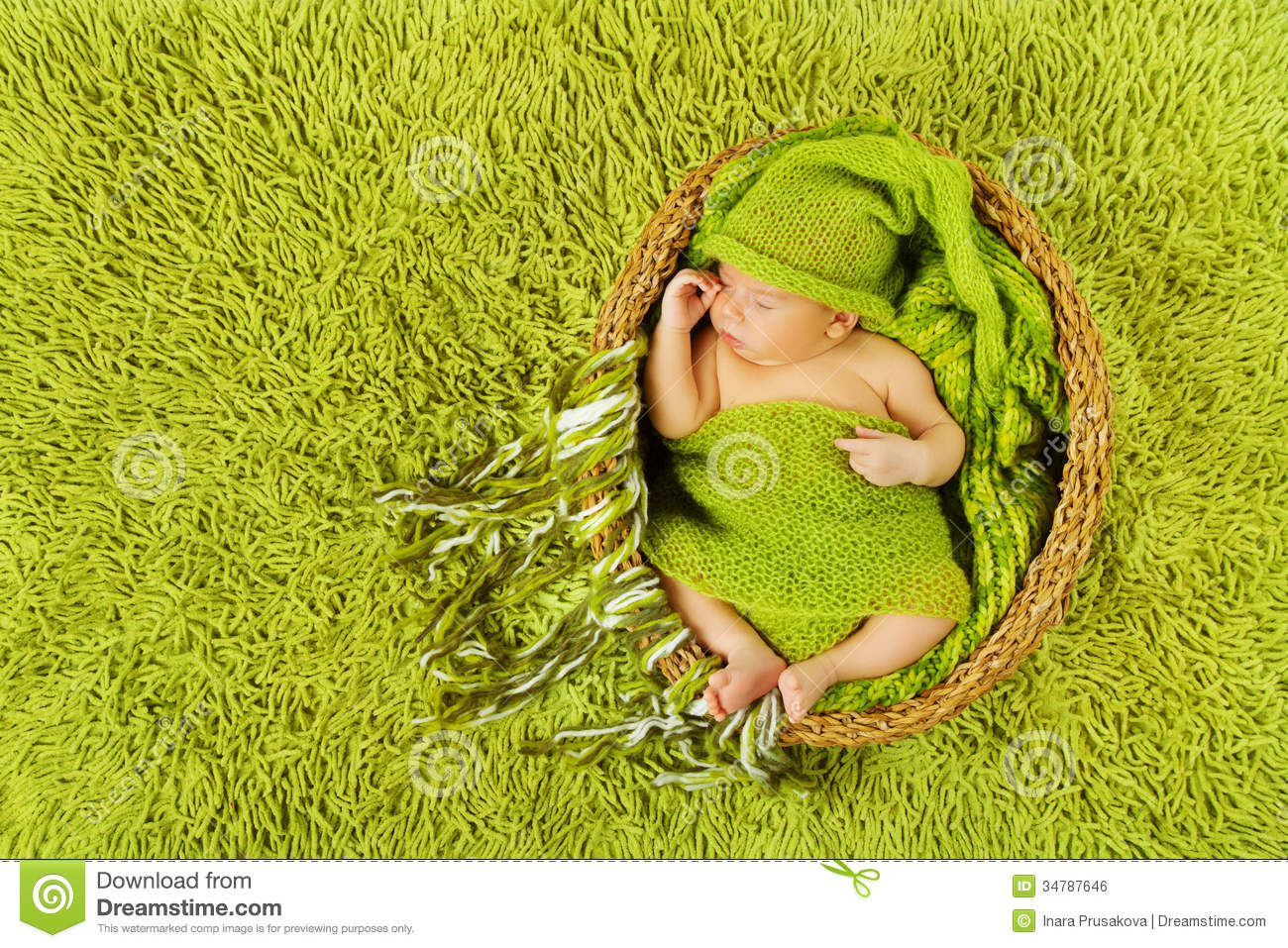 Baby Newborn Sleeping In Woolen Hat, Green Carpet Royalty