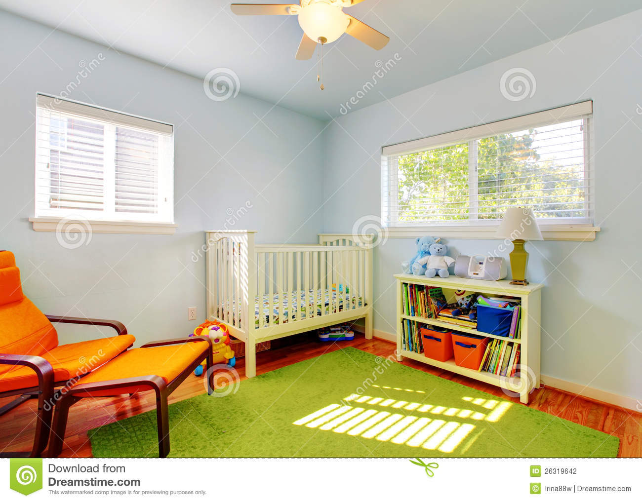 Baby Nursery Room Design With Green Rug, Blue Walls And Orange Chair ...