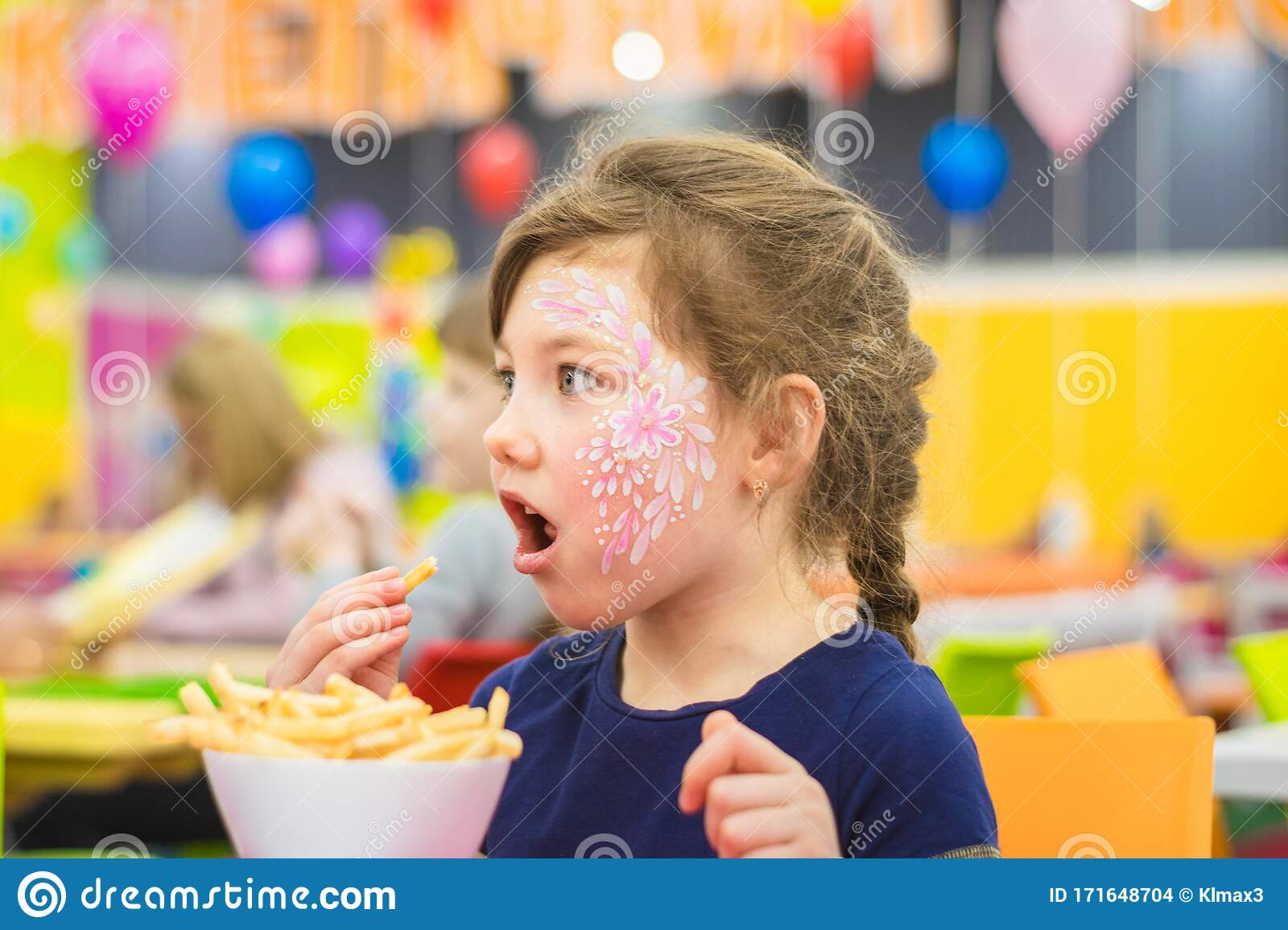 Baby Opening Her Mouth Eats Food From A Large Plate. A ...