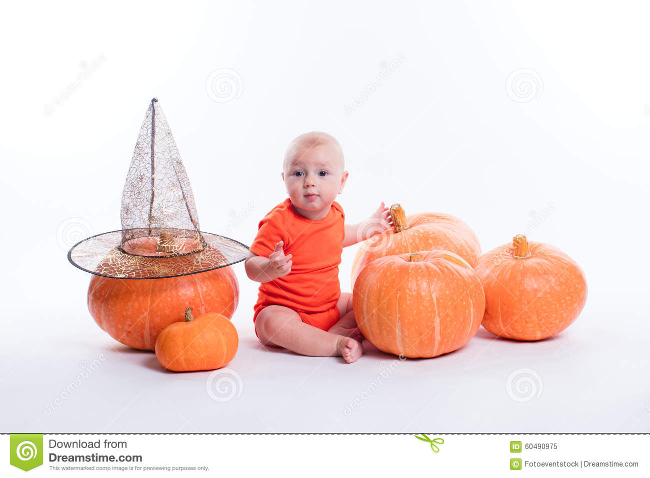 Baby in orange t-shirt sitting on a white background surrounded