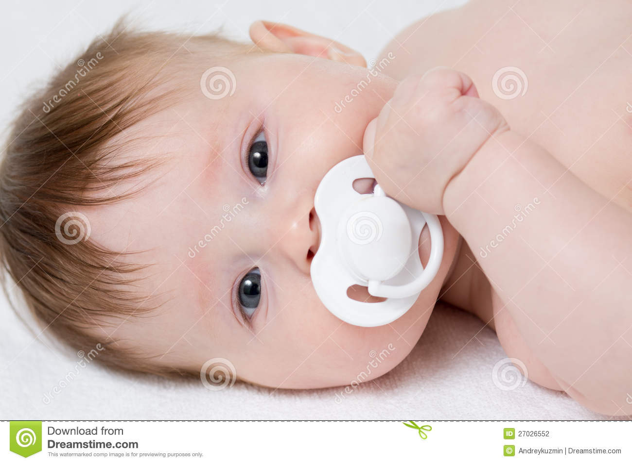 Baby with pacifier closeup
