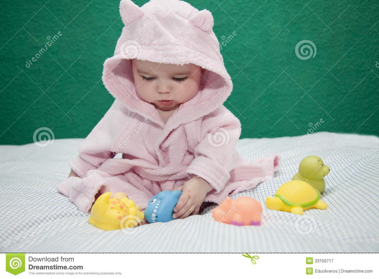 Baby playing with bathrobe