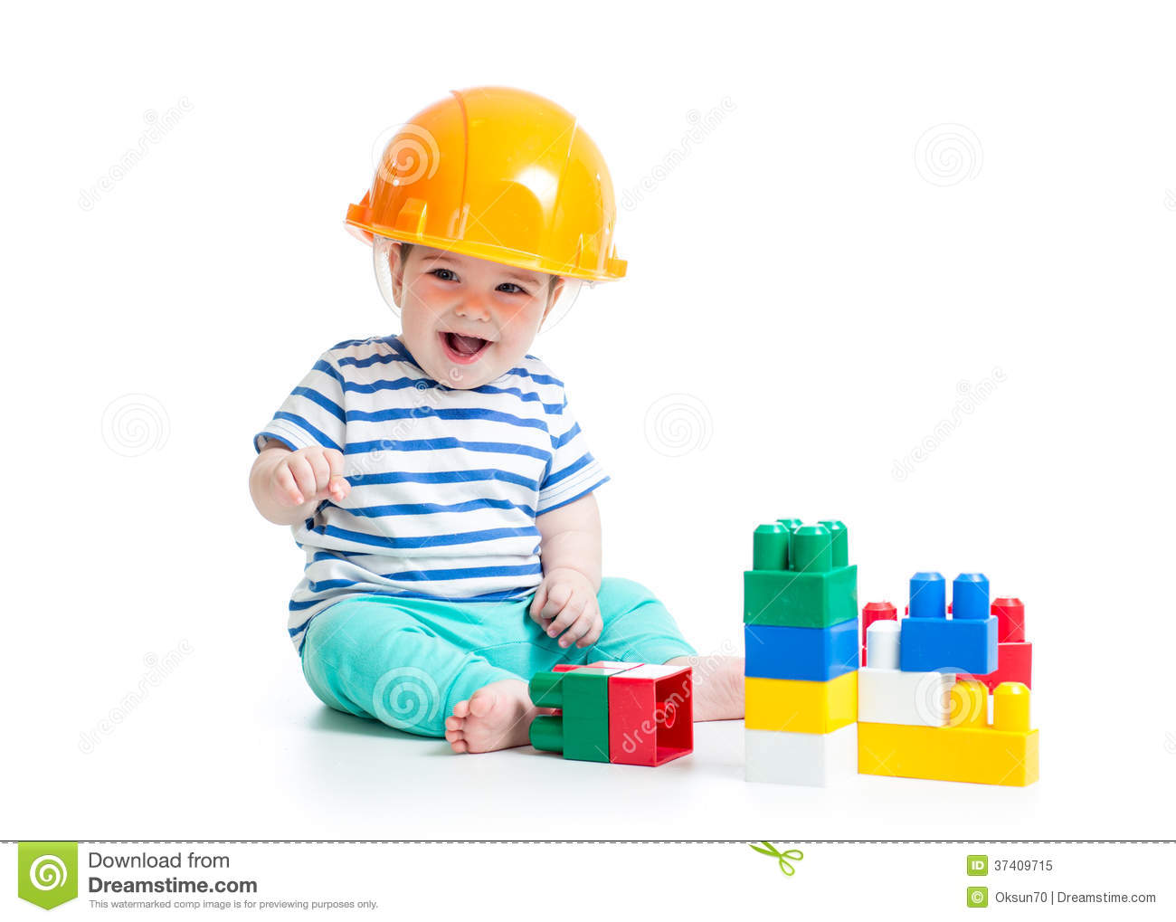 Building Toys For Babies : Baby boy in hard hat playing colorful building blocks