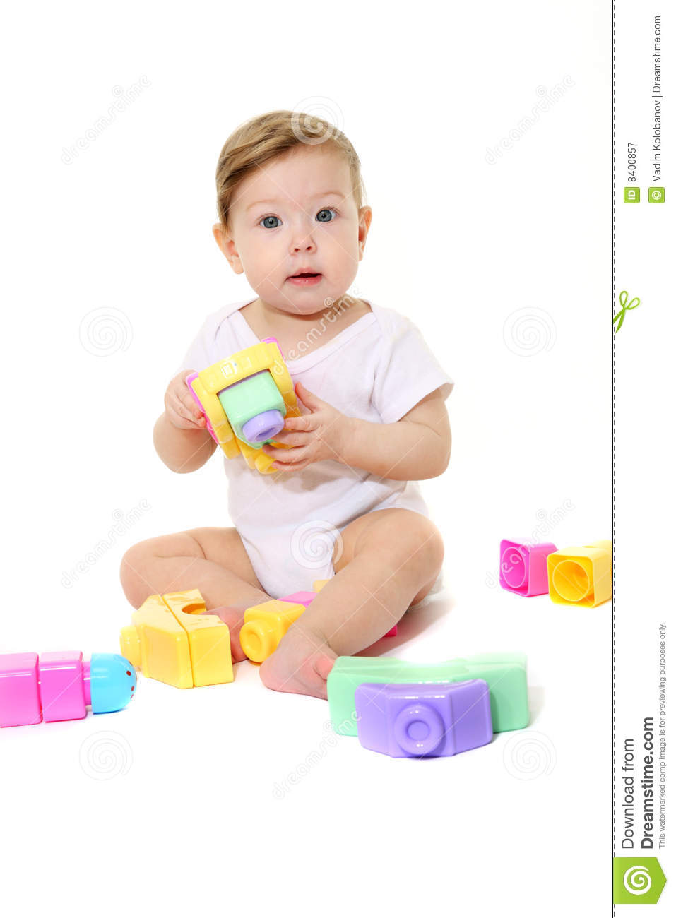 Play With Patterns Prints And Lots Of Accessories For: Baby Playing With Colored Blocks Royalty Free Stock