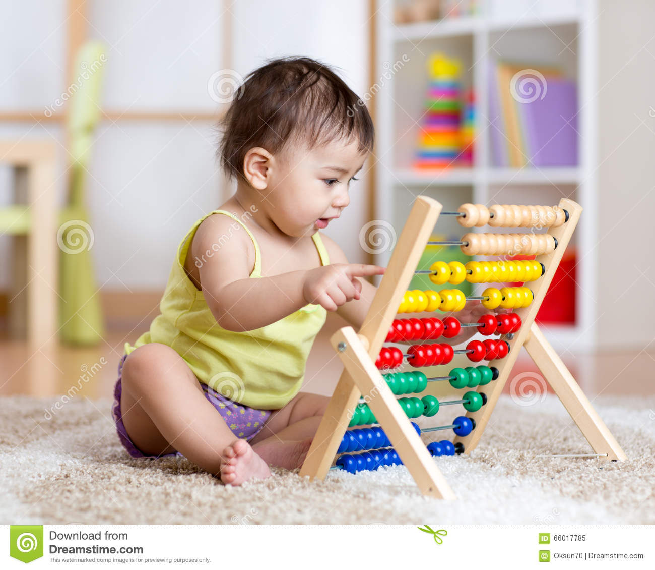 Learning Toys Toddler Girl : Little girl playing with abacus on playground stock photo