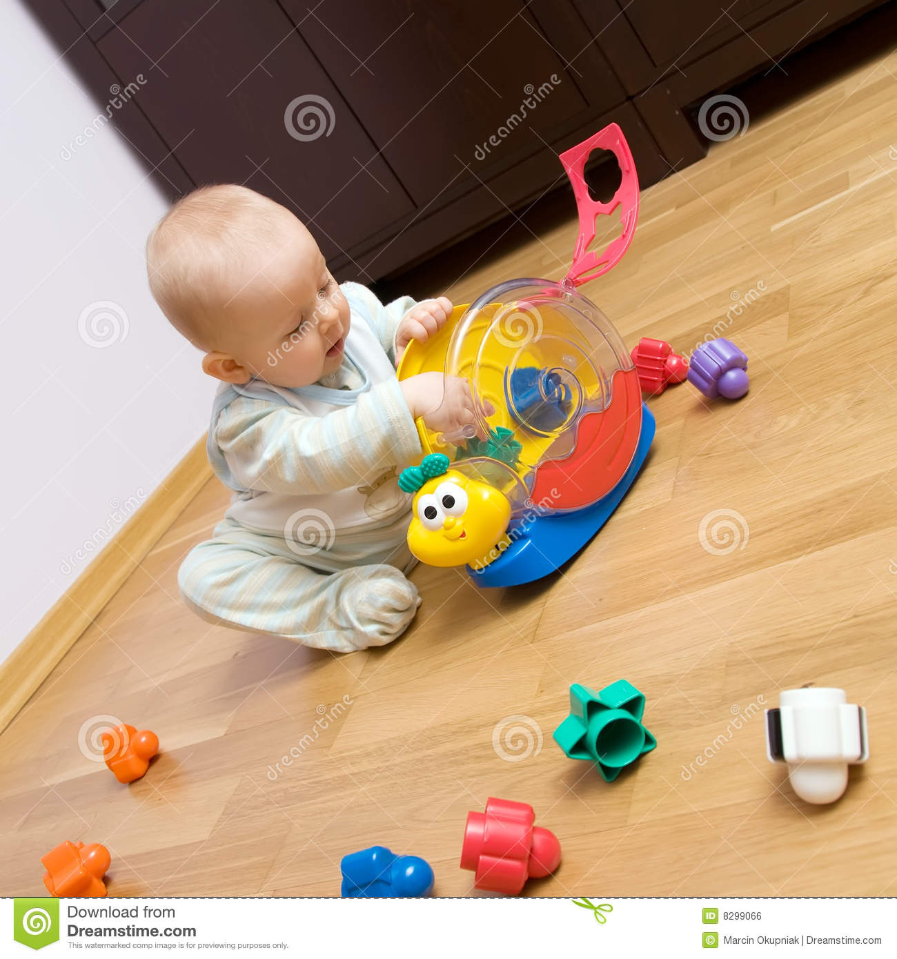 Baby playing with plastic toy