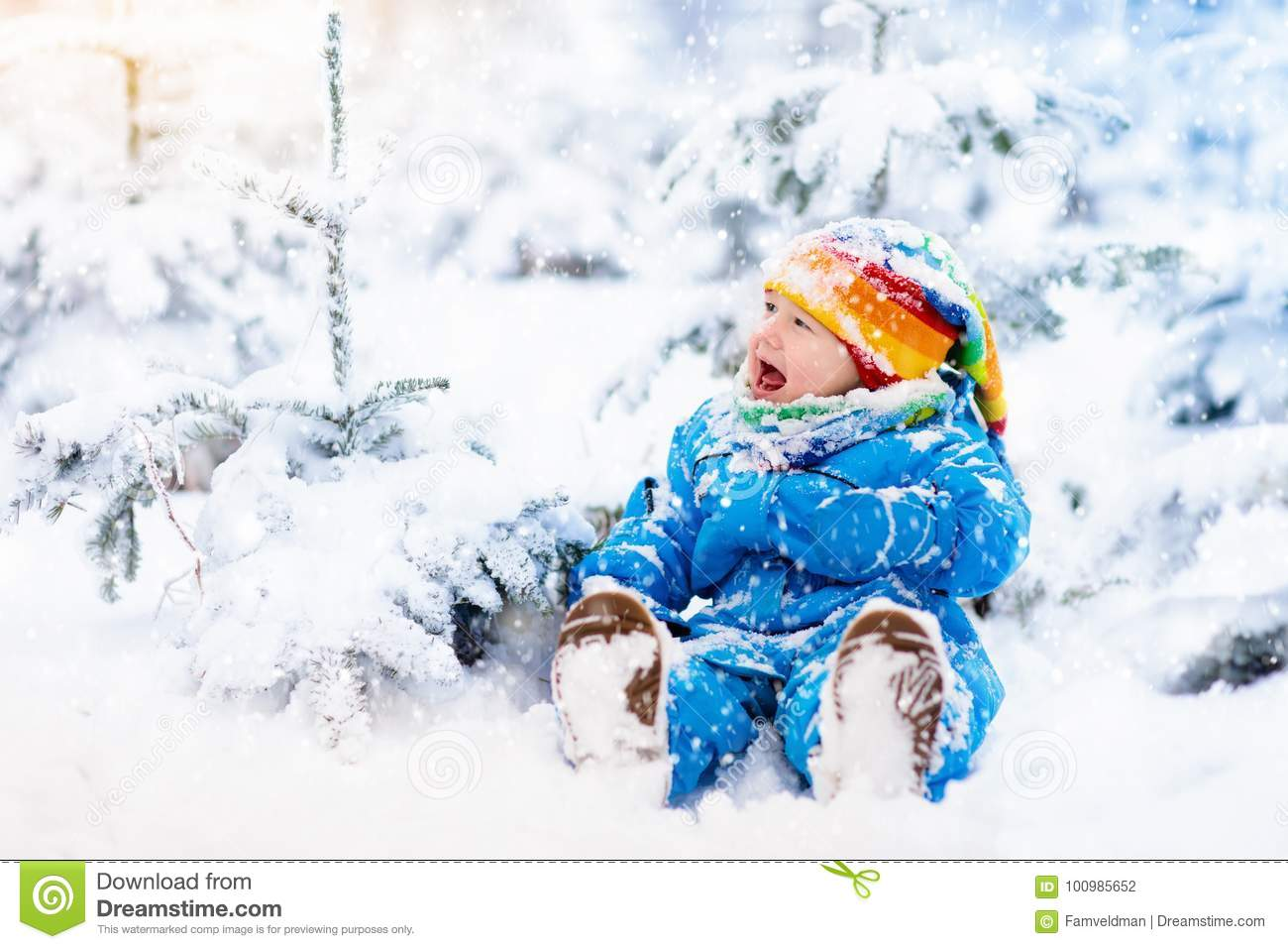 28965576da01 Baby Playing With Snow In Winter. Child In Snowy Park. Stock Photo ...