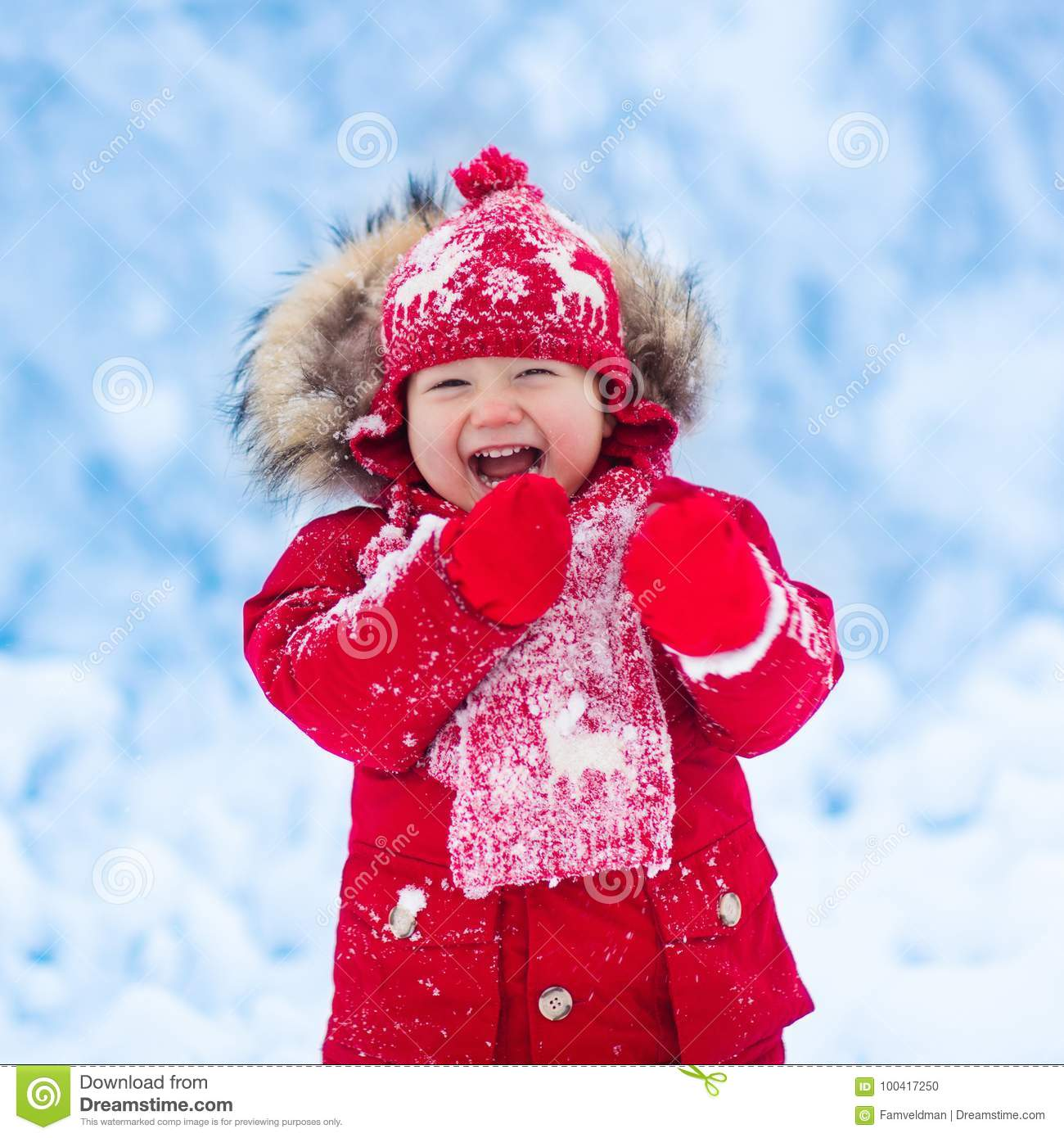 b60b75b8fbd2 Baby Playing With Snow In Winter. Stock Photo - Image of family ...