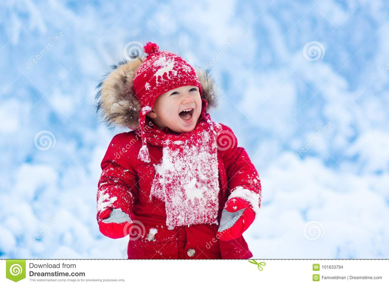 fa0fe052cb17 Baby Playing With Snow In Winter. Stock Photo - Image of reindeer ...