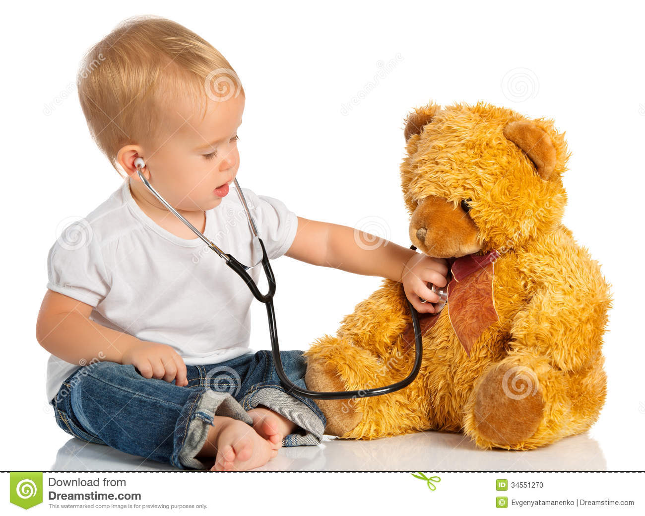 Baby plays in doctor toy bear, stethoscope