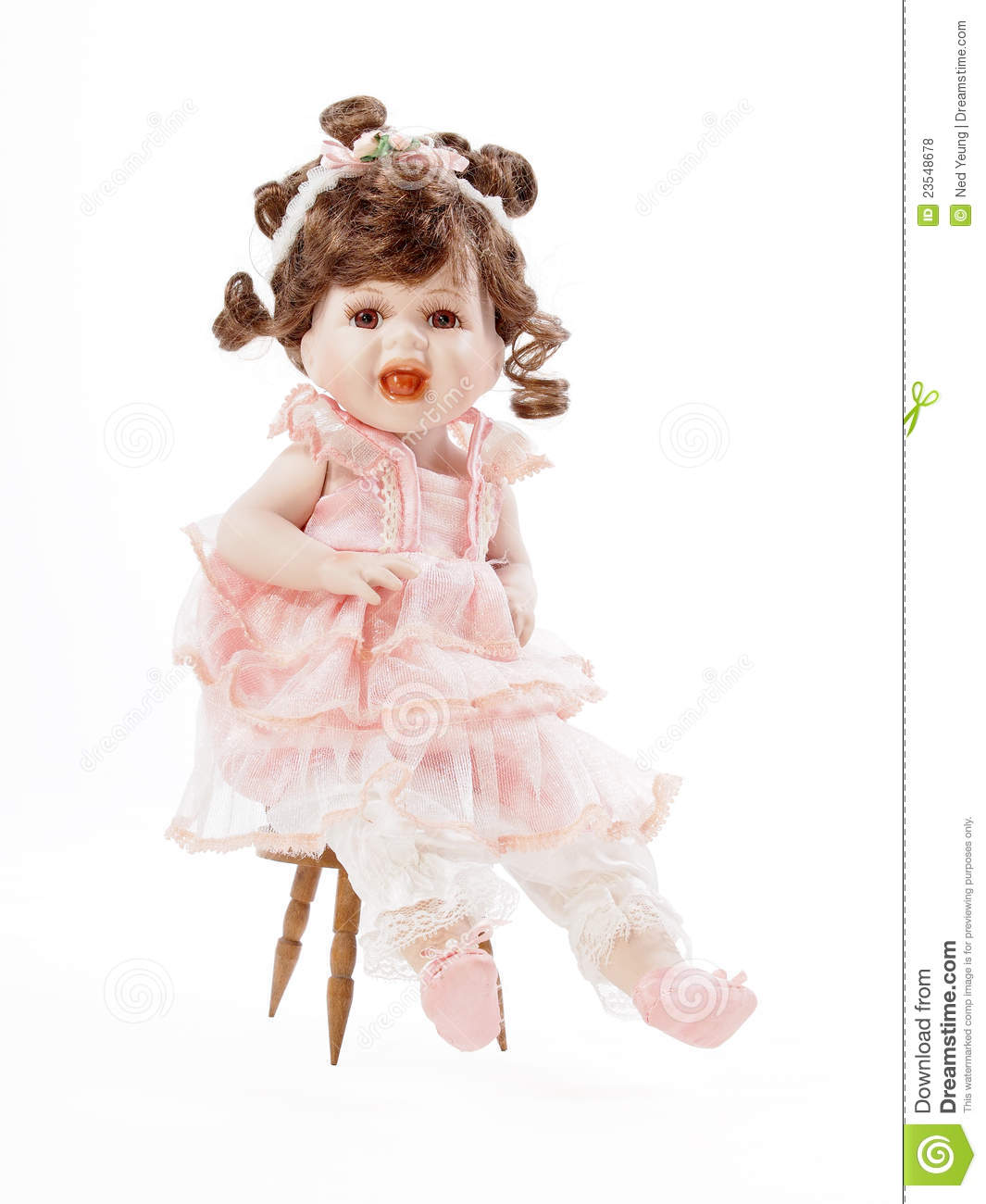 Baby Porcelain Doll sitting on a Wooden Chair