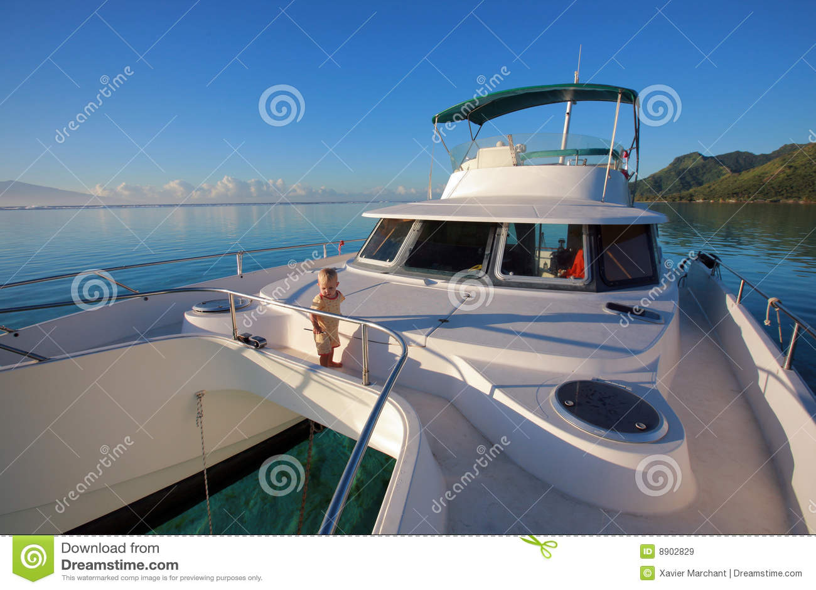 Baby on a power catamaran stock image image of island for Blue sea motor inn