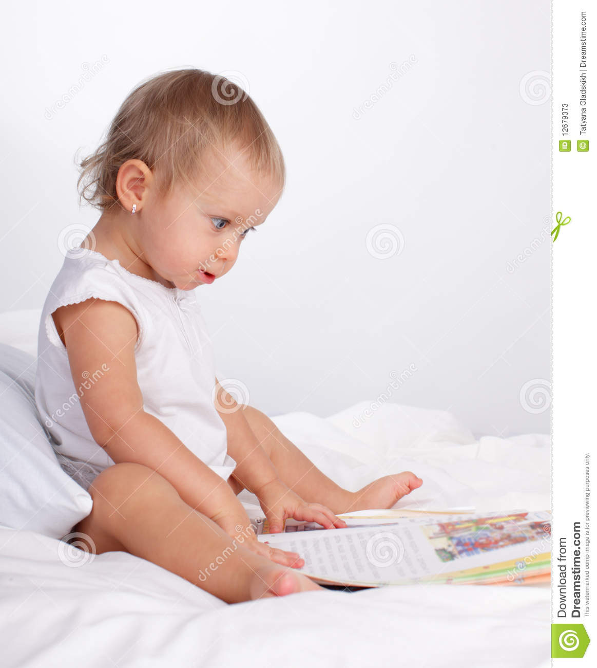 Baby Reading Book Stock Photos - Image: 12679373