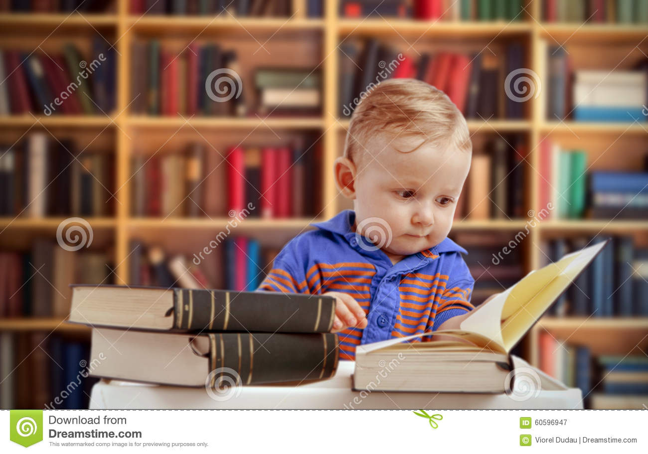 Baby reading in library - education concept