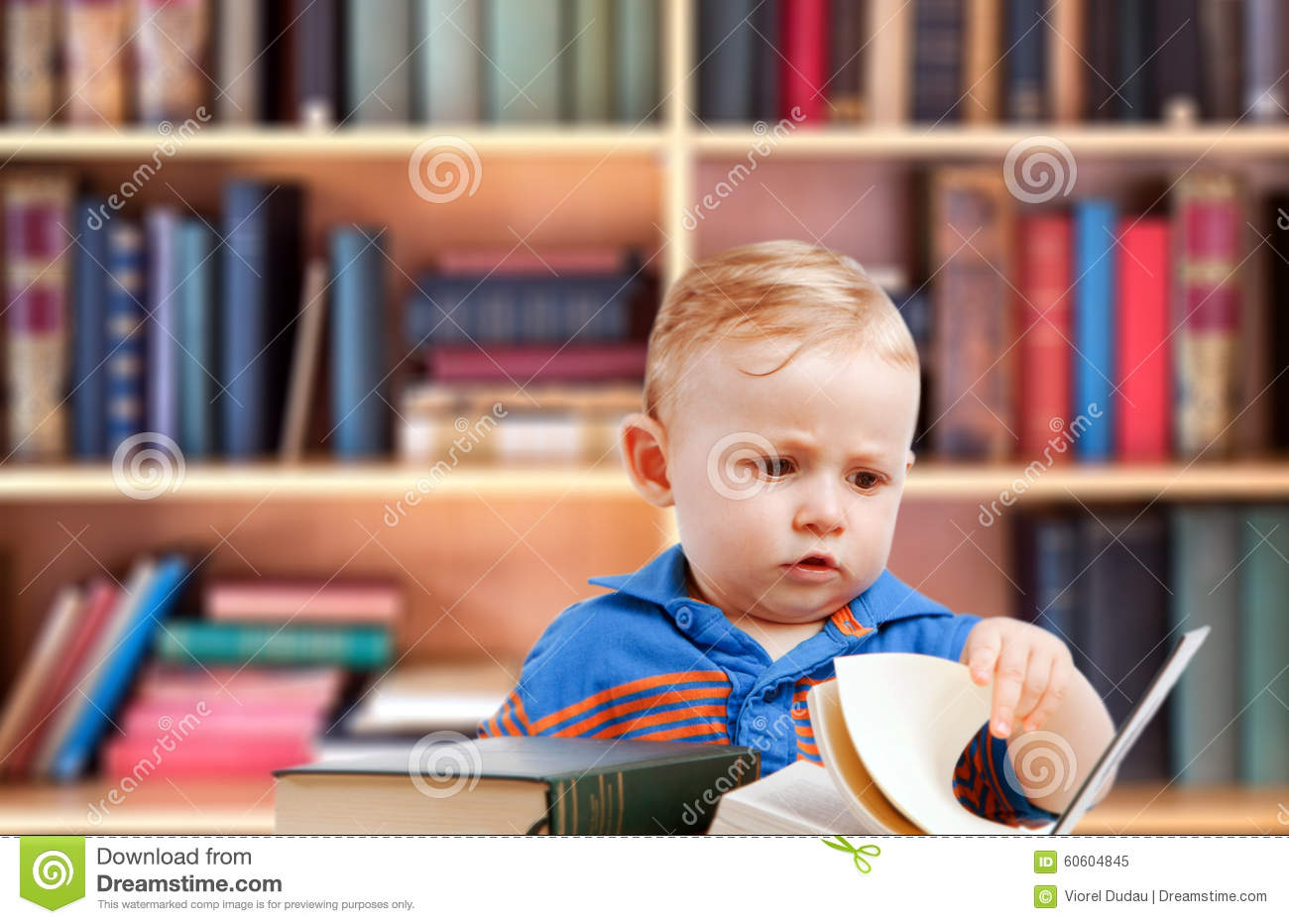 Baby reading in library