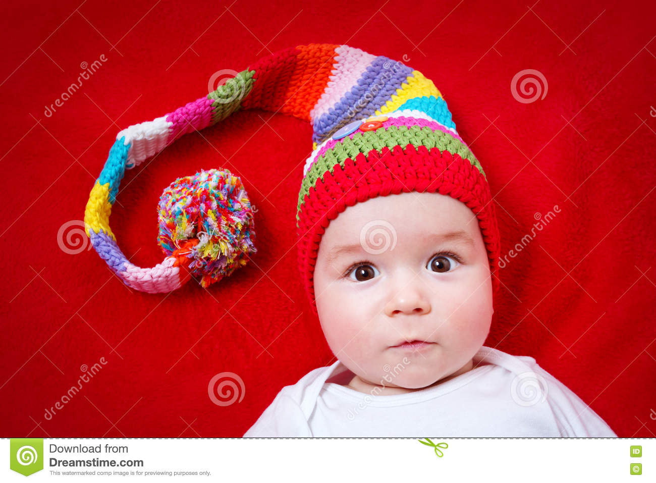 Baby in red and white hat
