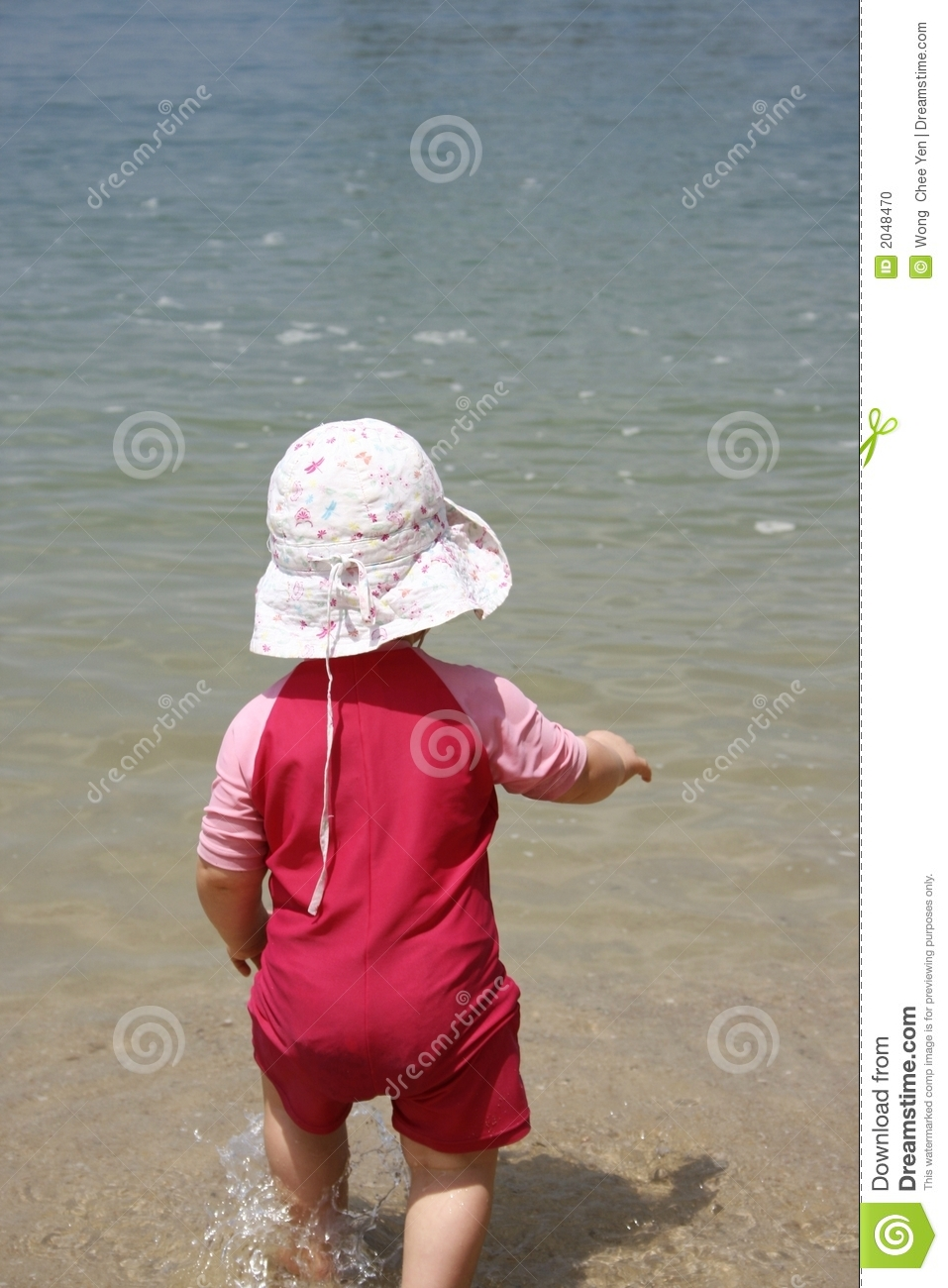Baby running into water