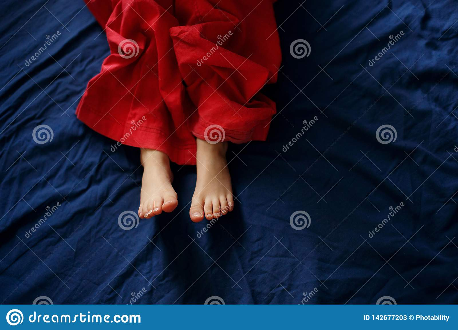 Baby`s feet on the bed