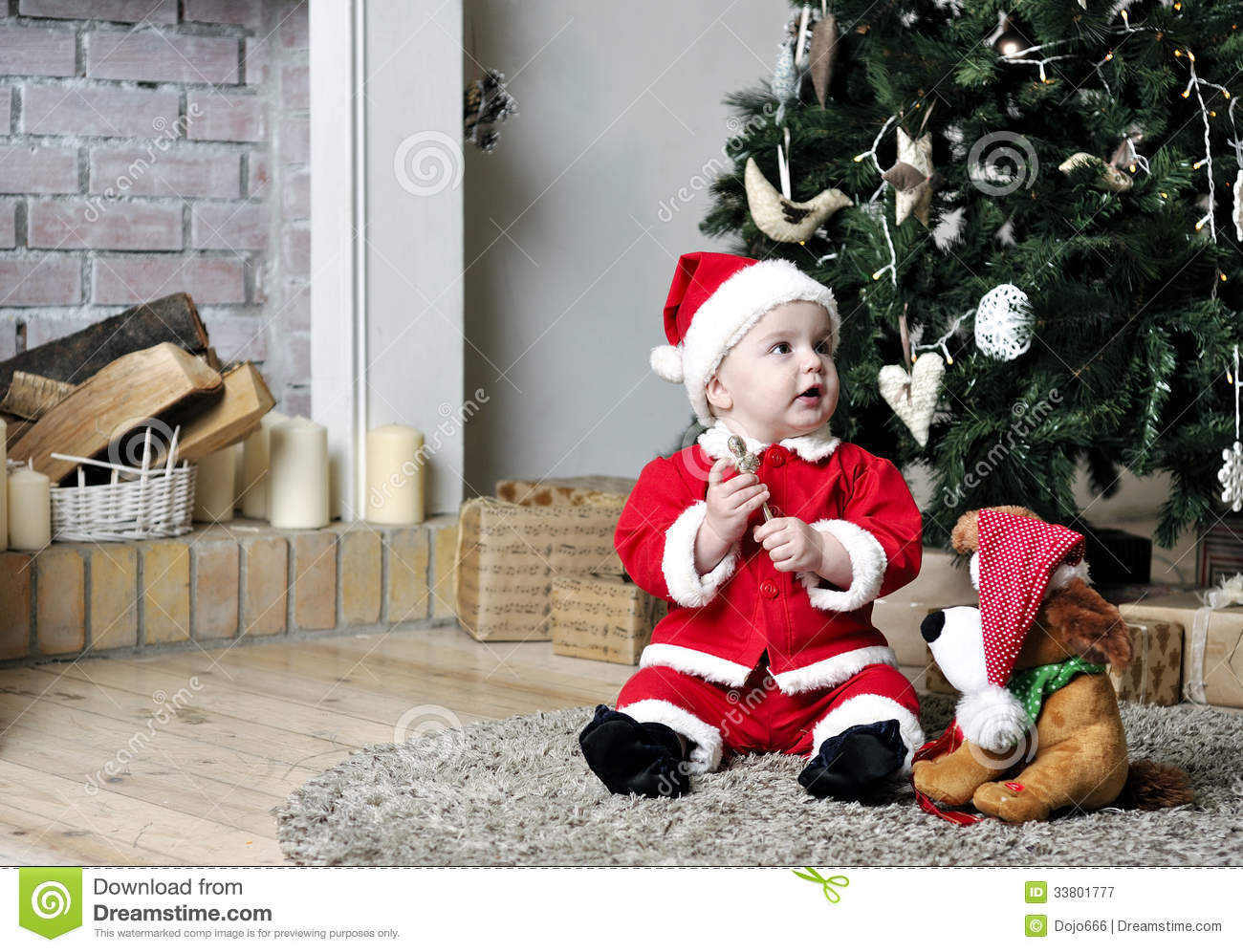 Baby In Santa Costume Sit Near Decorating Christmas Tree With Toy ...