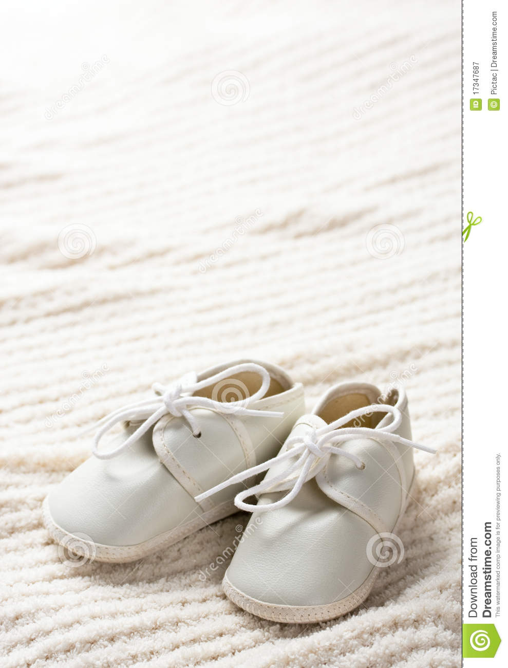 Baby Shoes And Blanket Royalty Free Stock Photography