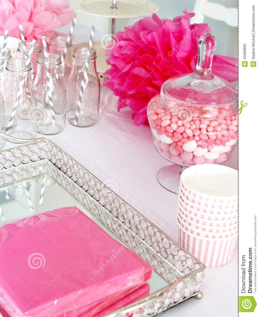 Paper cups mirrored tray napkins on a table with white tablecloth