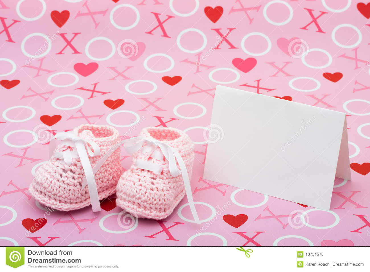 card with baby booties on a pink love background baby shower message