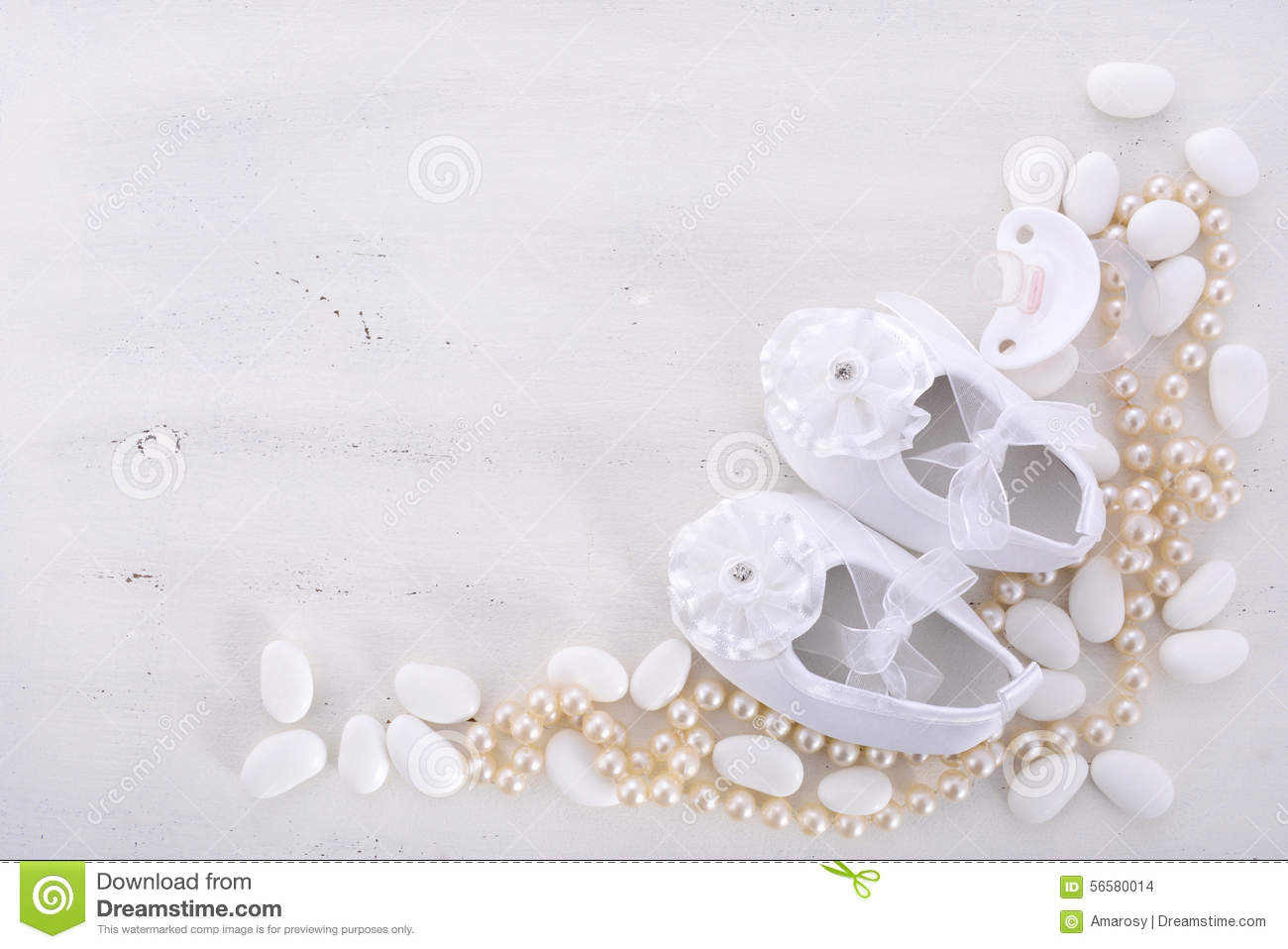 baby shower neutral white background with baby booties pearls and