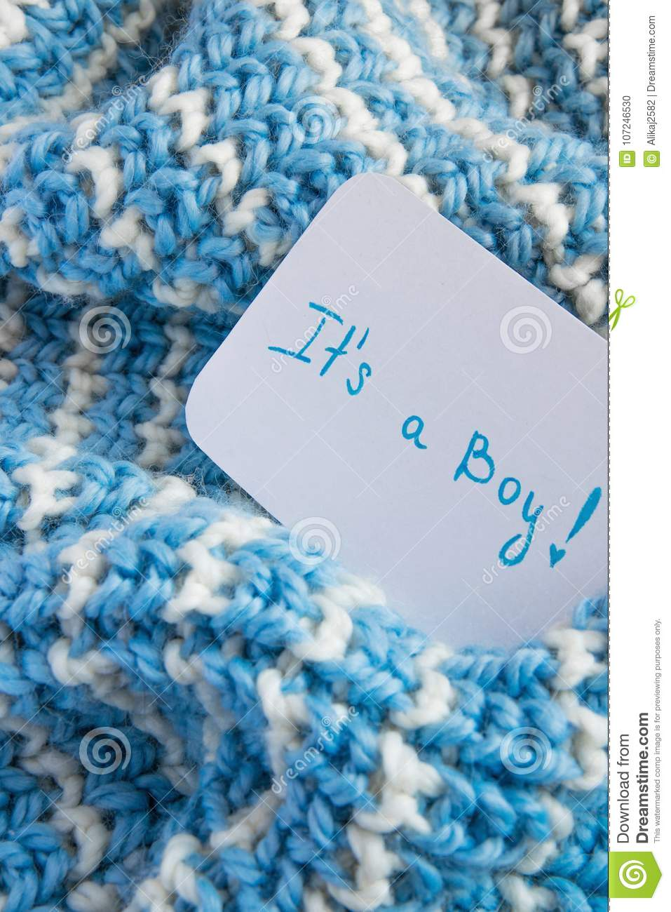 Baby shower `It`s a boy`, announcement card on cozy woolen blue blanket and space for text. New arrival in the family