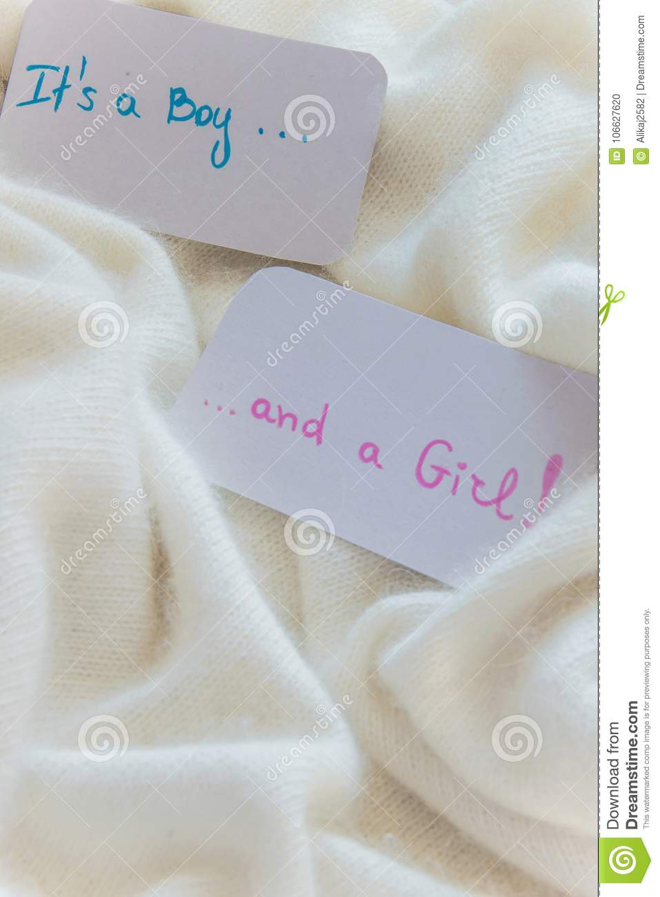 Baby shower `It`s a boy...and a girl`, announcement card on cozy warm white blanket with space for text. Twins arrivals