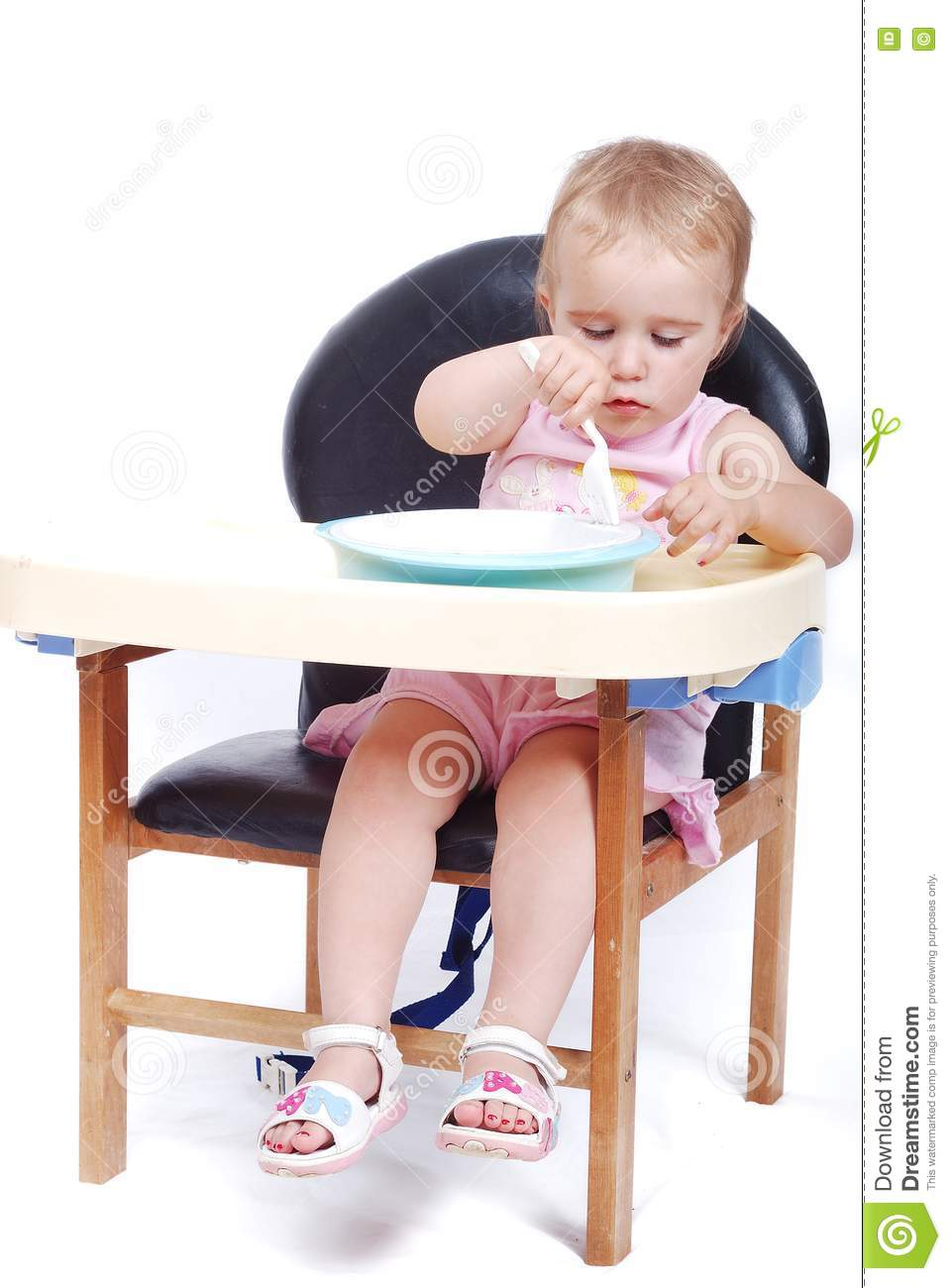 Baby sitting on the black chair isolated stock image for Toddler sitting chair