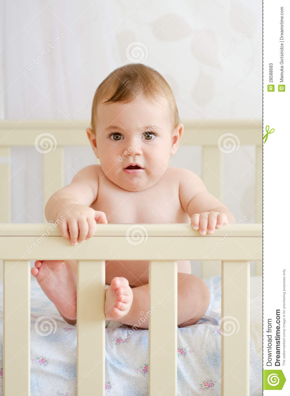 Baby Sitting In A Crib Stock Photos - Image 28588683-3484