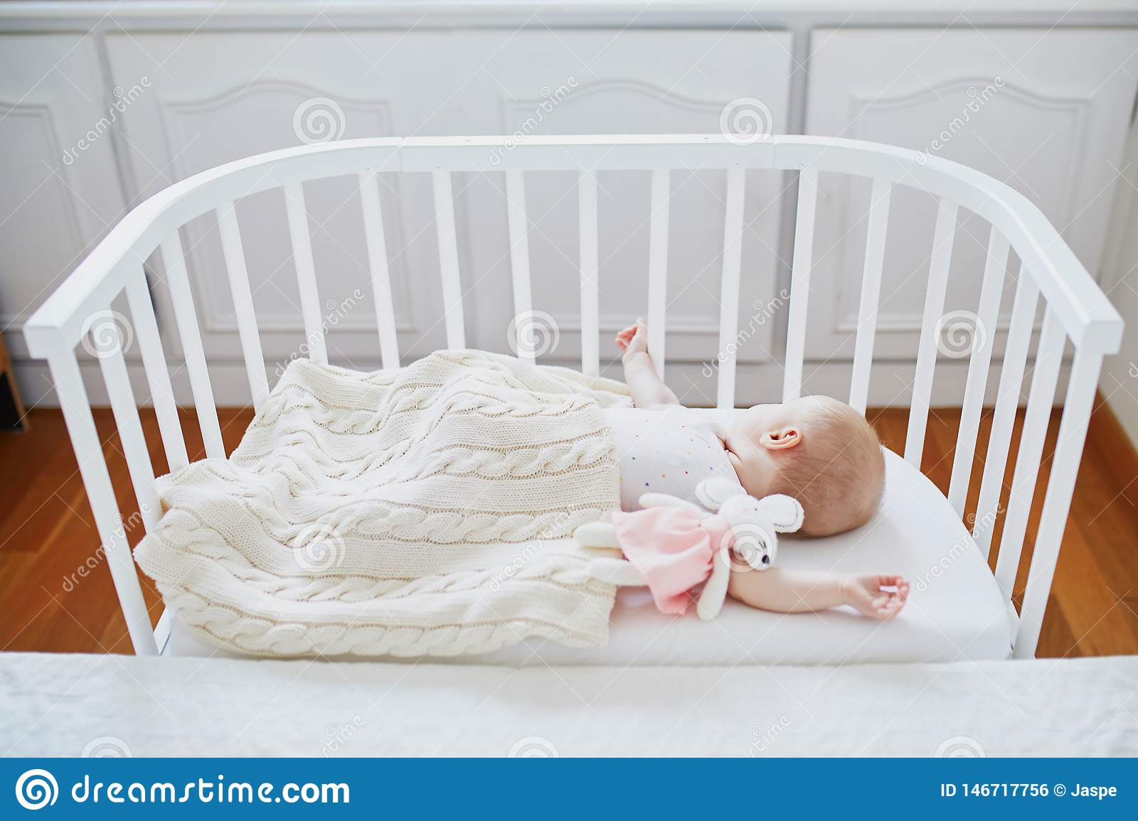 Baby Sleeping In Co-sleeper Crib Attached To Parents` Bed ...