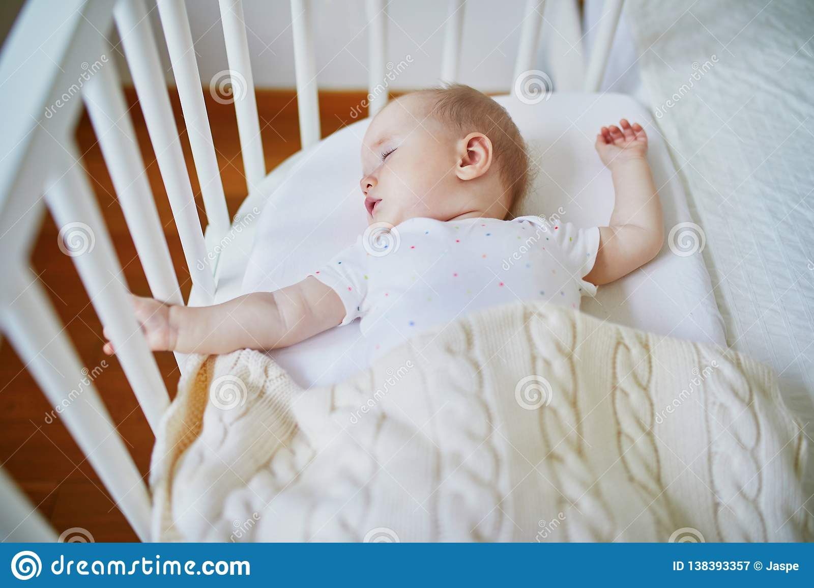 Baby Sleeping In Co-sleeper Crib Attached To Parents ` Bed ...