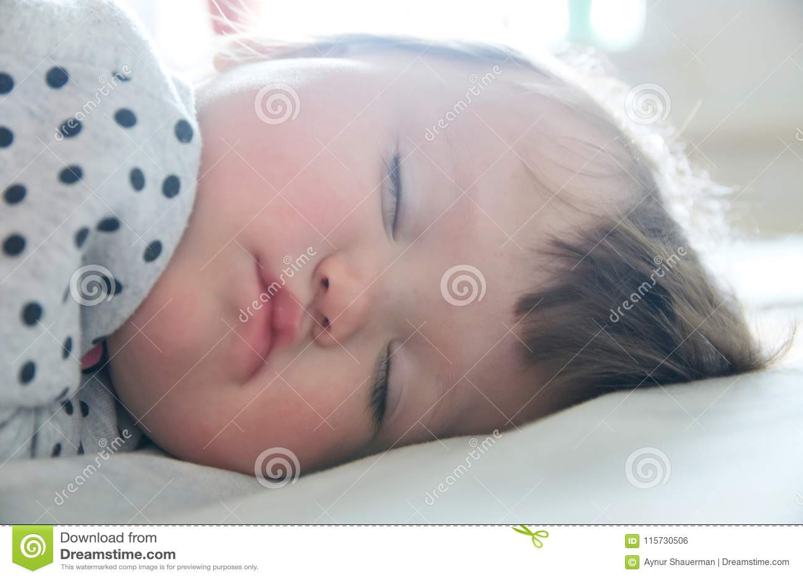 Baby sleeping portrait close up, health care. Little girl sleep cute