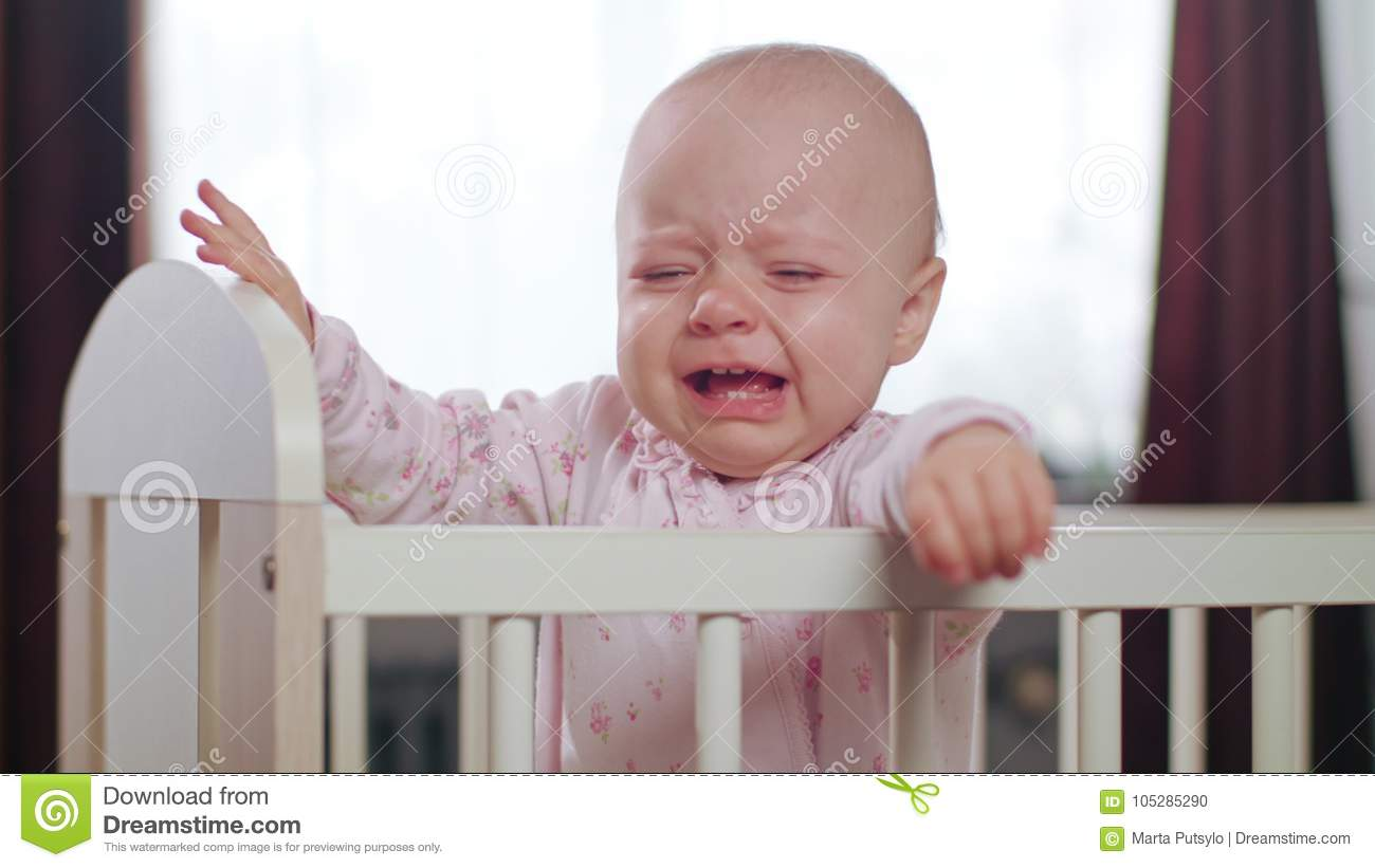 Baby Boy Crying In Bed Royalty Free Stock Photography