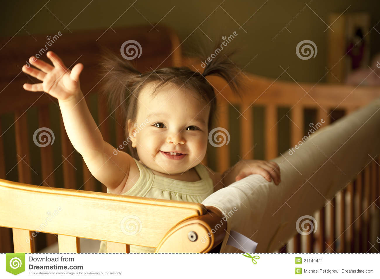 Baby standing up in crib