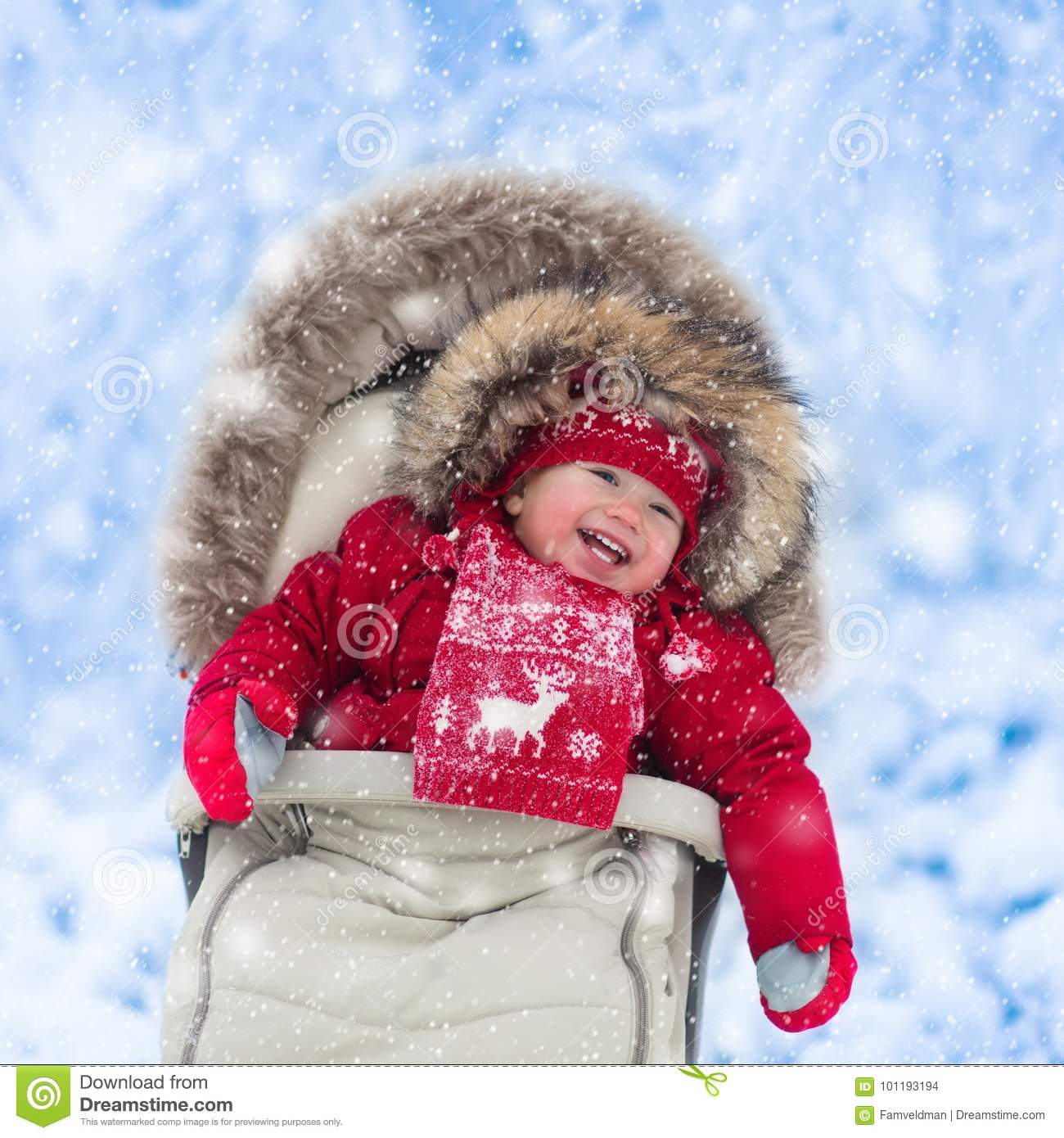 ed9e6af05 Baby In Stroller In Winter Park With Snow Stock Photo - Image of ...