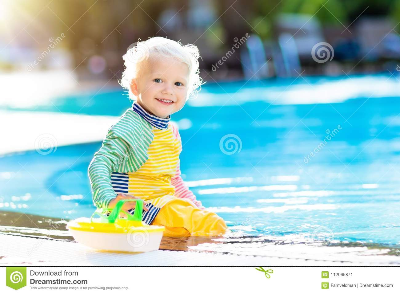 Baby In Swimming Pool  Family Summer Vacation  Stock Image