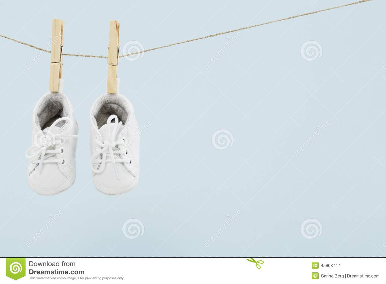baby wear hanging in clothespins on washing line royalty