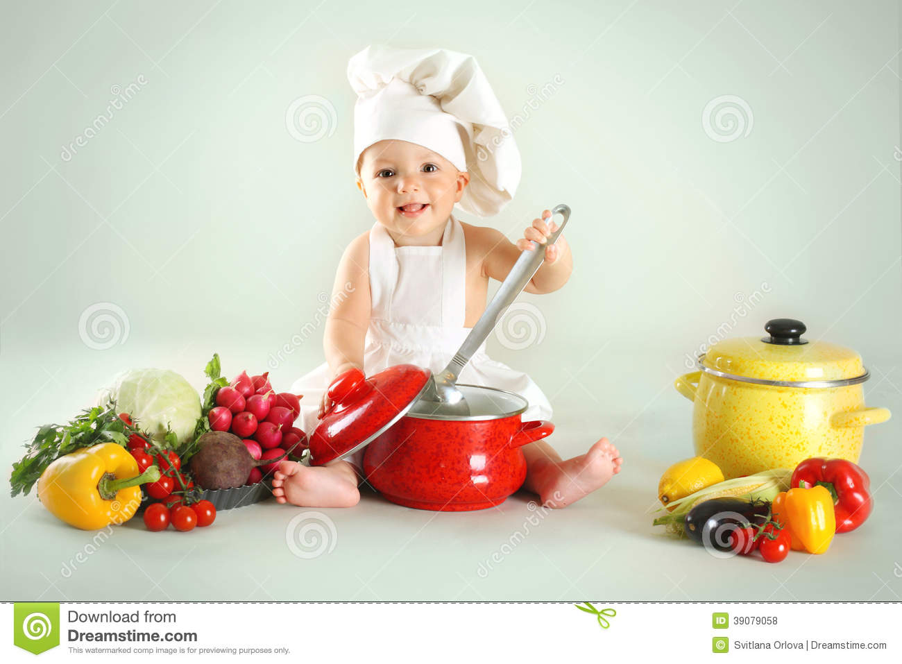 995e51aec19 Baby Wearing A Chef Hat With Vegetables And Pan Stock Photo - Image ...