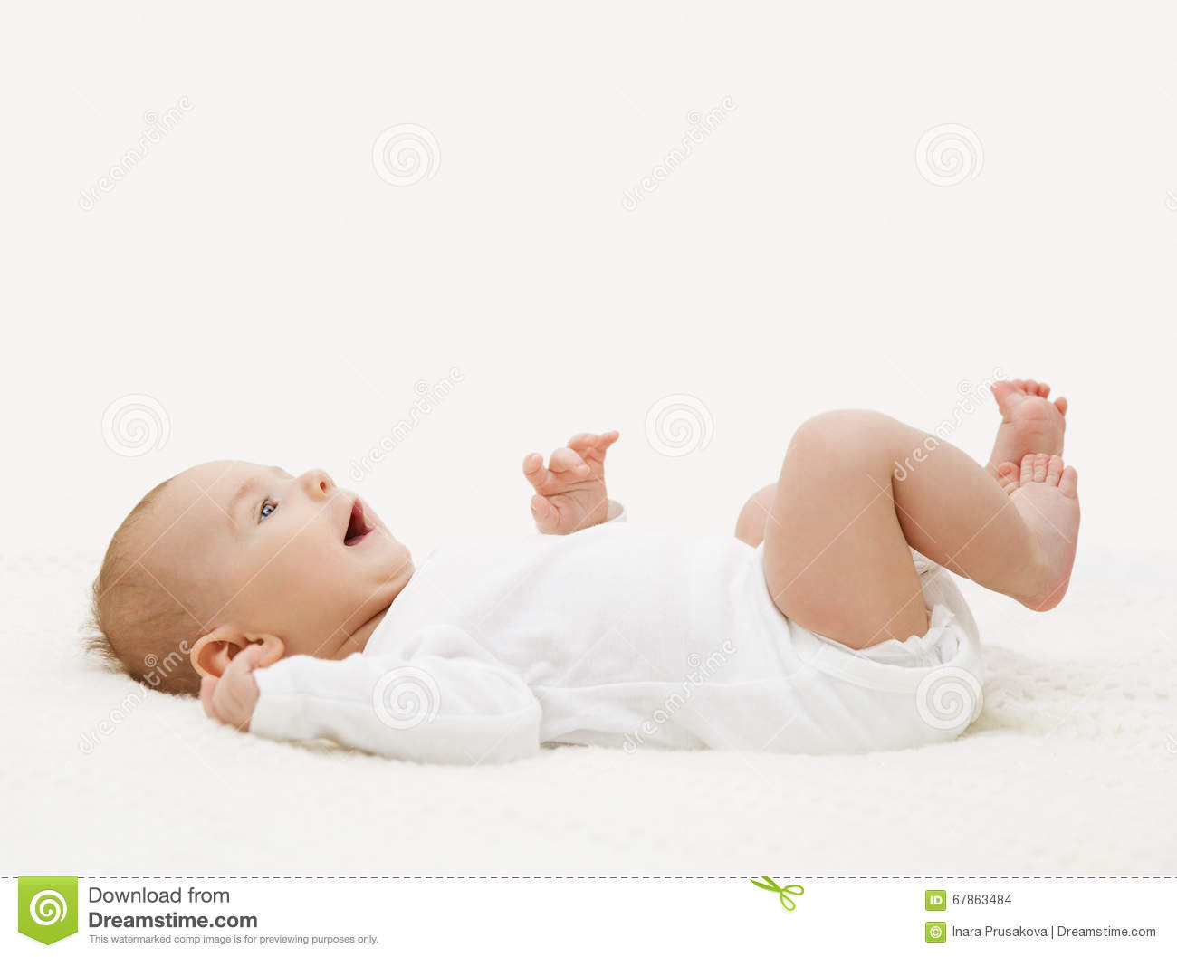 Baby In White Onesie Lying Down On Back Toddler In