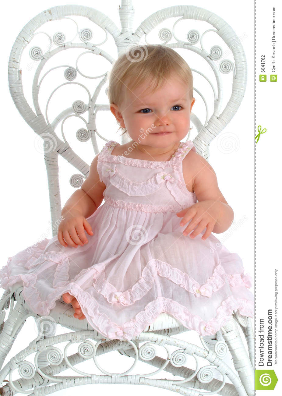 Baby in wicker chair stock photography image 6041762 for Toddler sitting chair