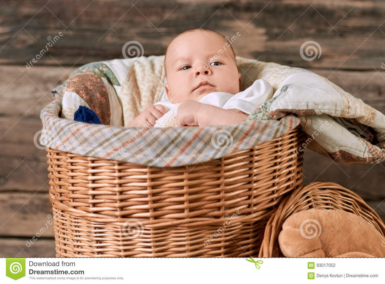 Baby in a willow basket.