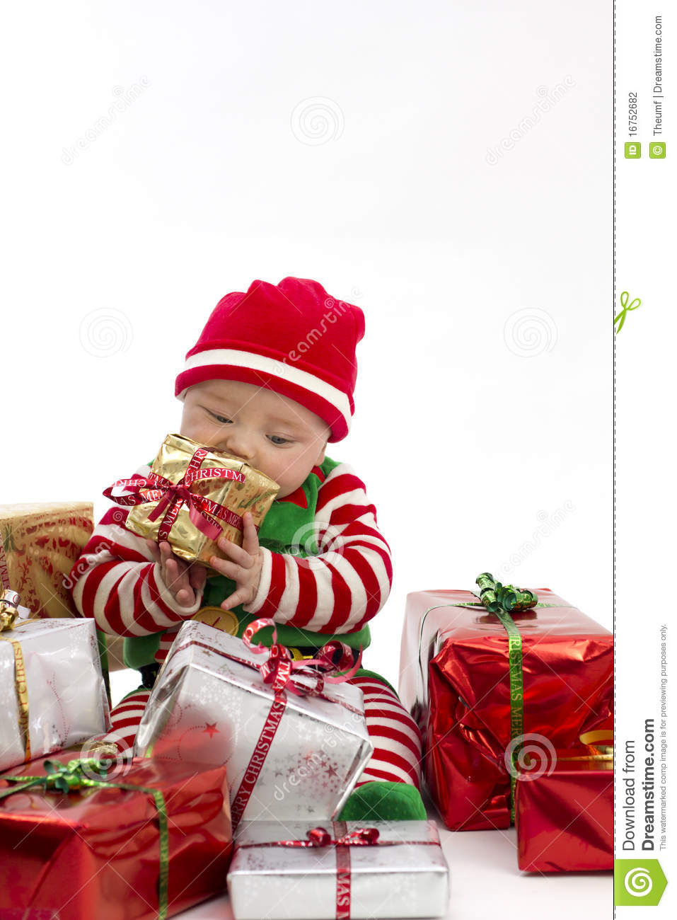 Babys First Christmas Eating Present Stock Photography - Image ...